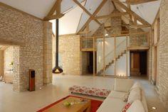 Scheunenumbau interieur design natursteinwand wohnzimmer