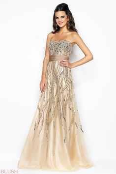 Formal prom dress in champagne elegance! Silver stones define your bust over tonal and silver swirls of beads. In stock size 10.  A must see!