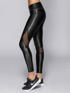 "Knock them out with our best selling tight. With sheer mesh panels across the back of the knees, you'll look as amazing going as you did coming. Fabric has a shiny metallic effect. - Inseam 27"" - Powe"
