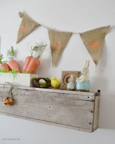 Easter Mantel With DIY Burlap Banner mycreativedays.com  Love the little clay pots that are dangling in the front.