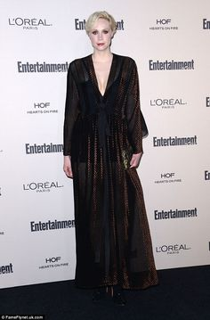 Ghostly: Gwendoline Christie looked very pale in her plunging sheer black gown...