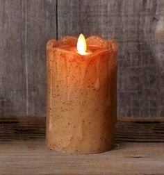 """5 inch Tan Primitive Flameless Pillar Candle. With it's life-like flickering """"flame,"""" his battery-operated pillar candle adds the ambiance of candlelight without the danger of fire! Accented with drippy wax and spices, this primitive style candle adds a warm and homey glow to a table, shelf or mantel."""