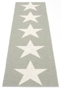 Pappelina's VIGGO runner features large vanilla stars on a warm grey background - flip it over to display the design in reverse.