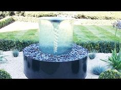 The stunning Volute water feature by Tills Innovations. A vortex being captured and displayed in clarity and detail. What appears to be a solid piece of glass with a spinning vortex. A mesmerising water feature. Vortex Fountain, Diy Water Fountain, Waterfall Fountain, Modern Fountain, Fountain Design, Landscaping With Fountains, Garden Fountains, Landscape Fountains, Water Fountains