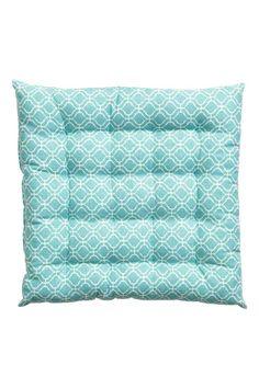 Подушка для сидения с рисунком: Подушка для сидения из х/б ткани с набивным рисунком. Толщина 4 см. Наполнитель - полиэстер.