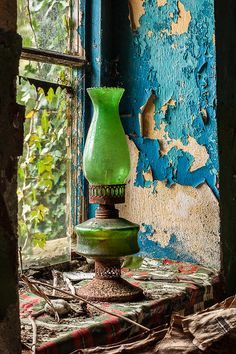 We'll keep the light on for you. Decadent decay, peeling paint, Green oil lamp found on a window sill in an abandoned cottage in the Republic of Ireland. Abandoned Houses, Abandoned Places, Peeling Paint, Window Sill, Oil Lamps, Belle Photo, Painting Inspiration, Still Life, Old Things