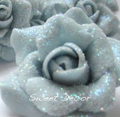 12 small hand made sugar roses with glitter sparkle finish. from SweetDecorUK at Folksy.com