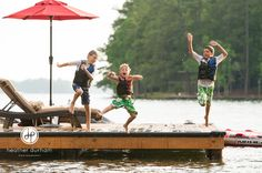 Boys/brothers jumping off a dock at the lake, Lake Martin photographer  http://www.heatherdurhamphotography.com