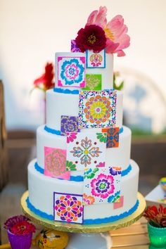colorful wedding cake, photo by Tami Melissa Photography http://ruffledblog.com/fiesta-on-the-farm-wedding #weddingcake #cakes