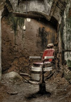 Barber chair inside an abandoned American prison in Fairmount District, Philadelphia, PA. (by e_monk)