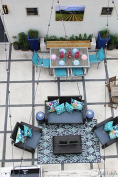 CREATE AN OUTDOOR LIVING ROOM! A bird's eye view of this colorful and inviting patio. Lots of inspiration and tips for decorating an outdoor space perfect for entertaining.