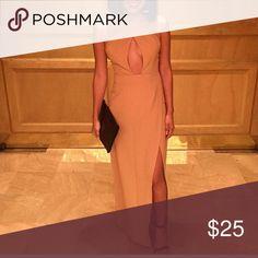 Khaki long dress Khaki long dress. Halter creates a keyhole cut in chest area. Has a slit. Missguided Dresses Prom