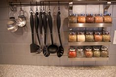 cool idea to use a small rod in your kitchen to hang things from..using hooks like you do for curtins.  I wonder if it would work in our kitchen with all our things... would just line the back part... hmmmm