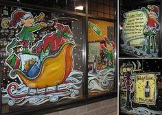 Liquor store window painting - elf throwing bottles of wine, store hours & specials
