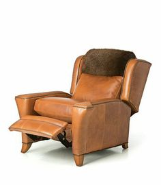 THE MARTINI LOUNGER is upholstered here in smooth Ute Adobe bison leather. The headrest is upholstered in American Bison sheared fur. This chair is a recliner and quite comfortable. It would be at home in your living room or den and harmonizes well with the Martini Sofa and Chair.