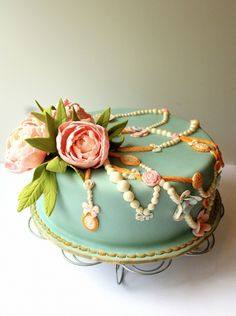 What a stunningly lovely vintage peony and jewelry bedecked cake. #cake #food #shabby #chic #vintage #peonies #jewelry #wedding #birthday