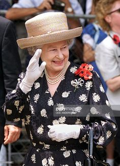 Queen Elizabeth II waves to wellwishers as she walks to church after laying a wreath honoring the dead of two world wars at the Cenotaph in Durban on Remembrance Sunday, 14 November the first. Get premium, high resolution news photos at Getty Images Royal Crown Jewels, Queen Hat, Remembrance Sunday, Foto Real, Royal Queen, Her Majesty The Queen, Elisabeth, Queen Of England, Queen Mother