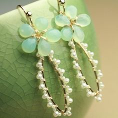 ...green tear beads and pearl wrapped earrings...........