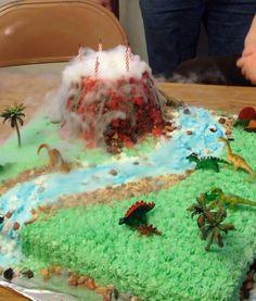 I shaped the volcano (chocolate Rice Krispies treat) aro. Dinosaur Train Party, Dinosaur Birthday Cakes, Dinosaur Cake, First Birthday Cakes, Chocolate Rice Krispies, Rice Krispie Treats, Mayonaise Cake, Hawaii Cake, Volcano Cake