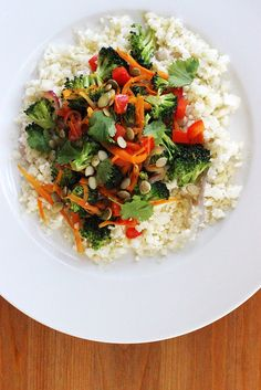 """This versatile cauliflower """"rice"""" goes far beyond your favorite stir-fry. Stop after step two, and let the cauliflower serve as a simple, light side to complement any main."""