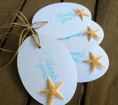 Miniature starfish favor tag accents.