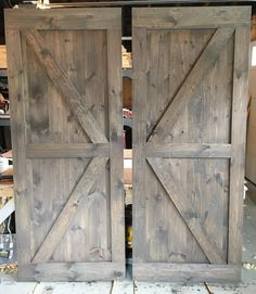 A pair of British Brace barn doors with a mix of Classic Grey and Special Walnut stain - a very popular color combo! #RusticRoo #barndoors #custom #handmade #woodworking