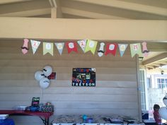 My set up in the garage includes the little man banner, mustache balloons, pictures of my little man on a birthday poster that I made, mustache table cloth, and candy stache table