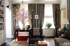 Designer Peter Marino used an Edmond Petit striped fabric for a New York library's walls and curtains.