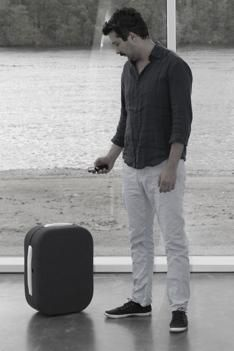 No more pulling suitcases along in the airport! This suitcase has receivers to triangulate the owners cellphone signal to be able to follow the owner using a caterpillar system.