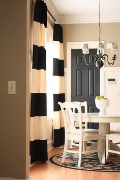 black interrior door with striped curtains...yes