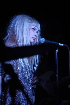 Mette Lindberg - The Asteroids Galaxy Tour  Blunt fringe, soft layers for volume. Tapered wispy ends. Fullness around head.