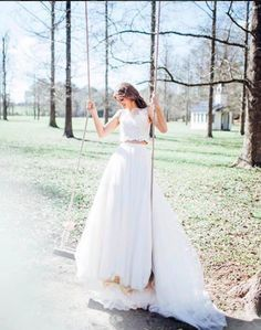 Loving this real Boho Morilee by Madeline Gardner bride in the Melina Two Piece Wedding Dress. Adorable Lace Crop top with Illusion Neckline and Back meeting a soft tulle A-Line skirt. Photo by Sara Gatlin.