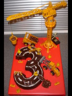 Construction Cake.  The 3 would be so easy to make with round cake pans.