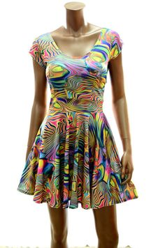 This stretchy skater style dress is made of four way stretch lycra spandex, in a gorgeous tropical swirl print.ξThe bodice has darts for shape, and a stretchy