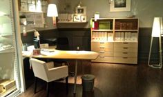 IKEA office space. GALANT corner desk and shelves.