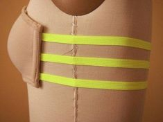 Sew elastic straps into a cheap bra in order to make a cheap, fancy strapless bra to wear under open-backed shirts.