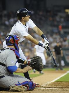Tigers' Ian Kinsler (3) connects for an RBI single