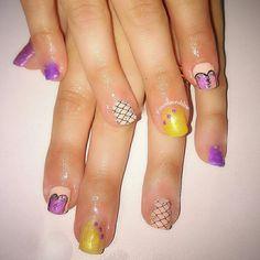 Gel extensions.    Burlesque inspired.  Gold. Purple. Pink black