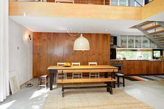 High Ceiling Under Kitchen Also Dining Space Among Long Wooden Table And Oversized Lamp