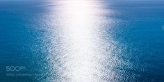 """A beam of sunlight reflecting over rippled dark blue water Go to http://iBoatCity.com and use code PINTEREST for free shipping on your first order! (Lower 48 USA Only). Sign up for our email newsletter to get your free guide: """"Boat Buyer's Guide for Beginners."""""""
