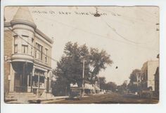 Main Street looking east in Homewood Illinois. Louis Mueller store on left. Likely 1908-1915 time period.