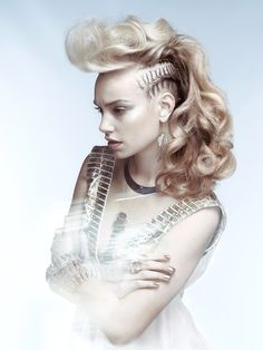 curly faux mohawk with braided sides. modern hairstyle.