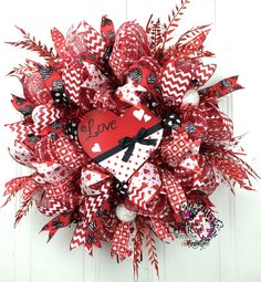 Deco Mesh Valentine's Day Door Wreath with red love heart sign by www.southerncharmwreaths.com #valentines #decor #party
