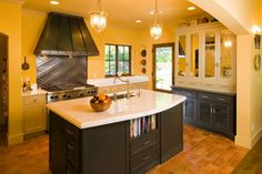 Classic kitchen design in yellow with charcoal gray cabinets. From 1 of 17 projects by Riverland Homes. Kitchen Cabinet Colors, Kitchen Colors, Kitchen Design, Kitchen Cabinets, Grey Cabinets, Modern House Design, Backsplash, House Warming, Home Office