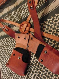 """hand made top grain leather holster for an Iphone or PDA and a standard sized wallet. snap closures keep everything secure. holster is adjustable by the use of screw backed rivets, one size fits most. Iphone/PDA pocket is 6 3/4"""" deep, 3"""" wide, and 3/4"""" high. $120"""