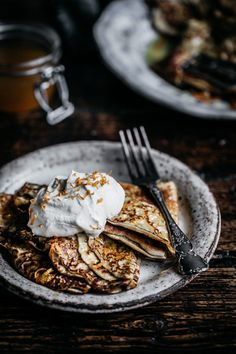 Soft fluffy crepes dipped in a citrus sauce and served with softly whipped cream; the perfect way to start the weekend. Anisa Sabet | The Macadames | Food Styling | Food Photography | Props | Moody | Food Blogger | Recipes