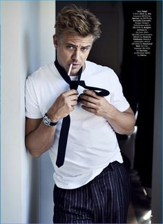 Wearing a white AG t-shirt with striped Berluti trousers, Boyd Holbrook stars in a photo shoot for the November 2016 issue of Esquire.