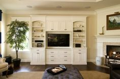 corner firelplace with builtins   Built-ins corner fireplace.