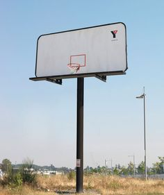 YMCA billboard. Try to shoot hoops in that thing! Did you know the YMCA invented basketball? #ymca #nochance