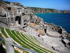 No, this is Cornwall. The Minack Theatre is an open-air theatre, constructed above a gully with a rocky granite outcrop jutting into the sea. The theatre is at Porthcurno, 4 miles from Land's End in Cornwall, England. Uk Landscapes, Open Air Theater, Cornwall England, West Cornwall, Most Beautiful Beaches, Beautiful Places, Tourist Places, Beaches In The World, Architecture